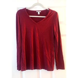 Long sleeve loose fitting red T-shirt.